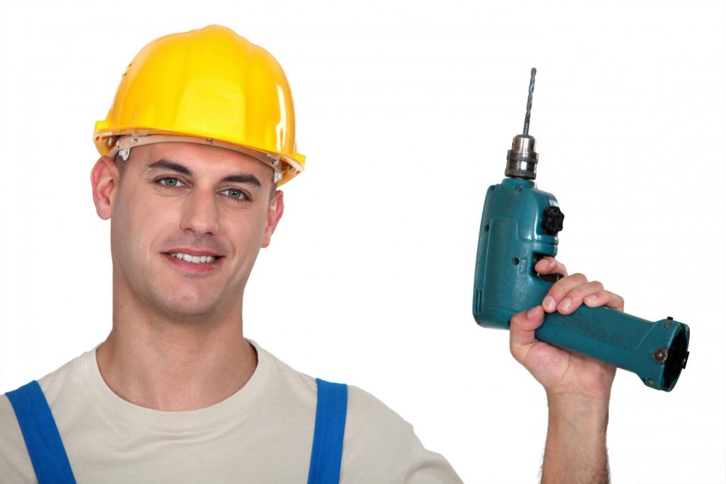 carpenter man holding a drill