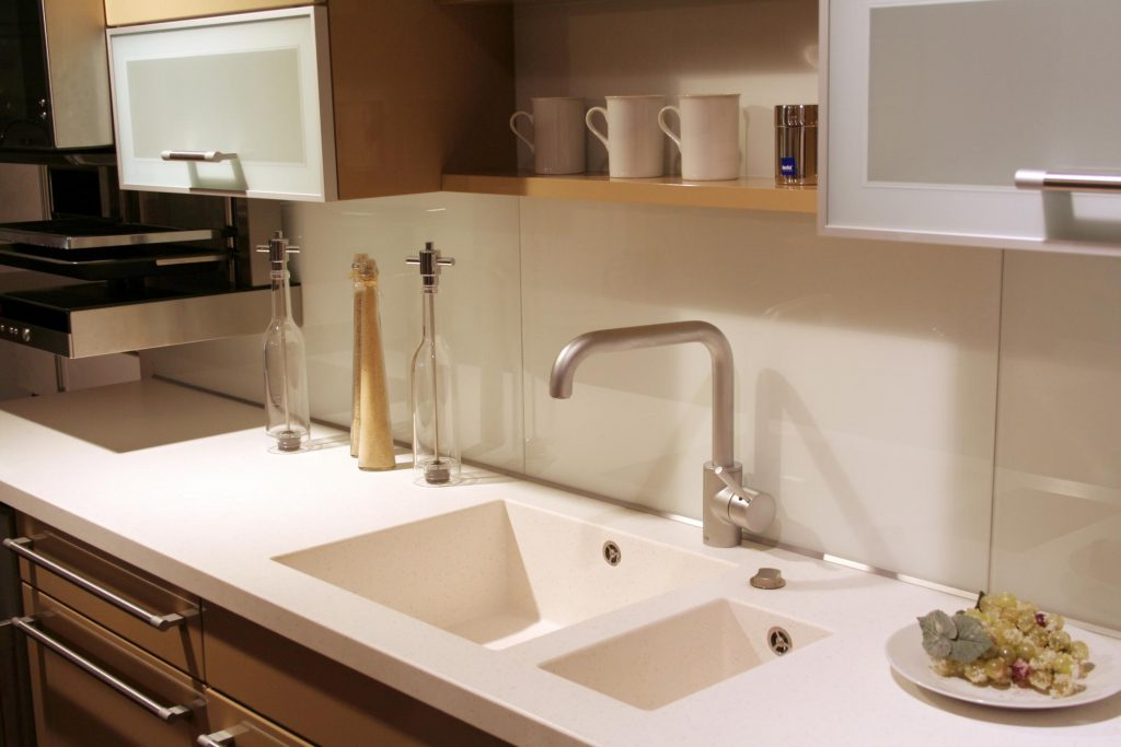 clean and neat kitchen sink and counter tops