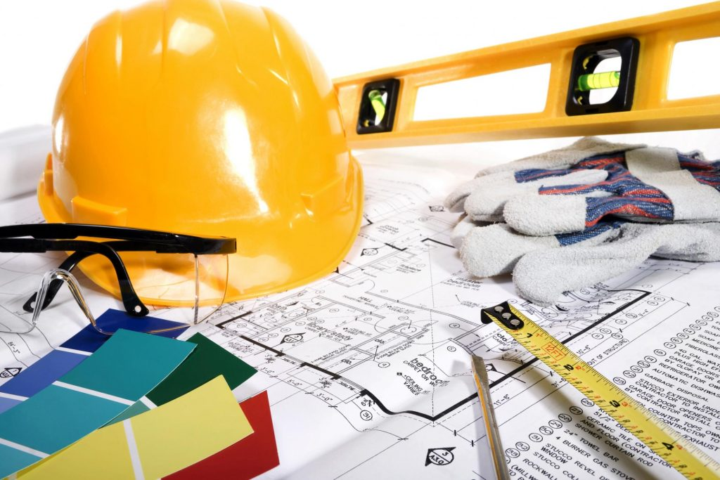 a map and other tools for remodeling or finishing a house